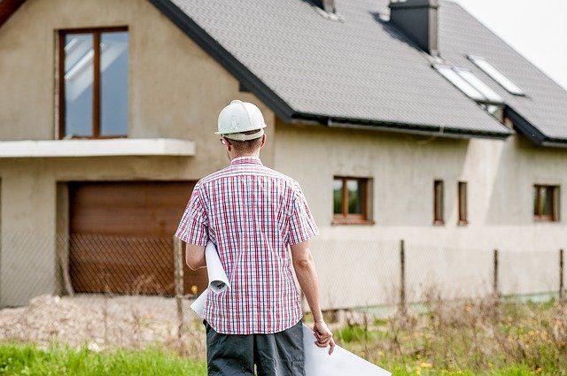 man walking to house