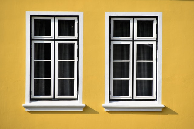 white windows on yellow wall